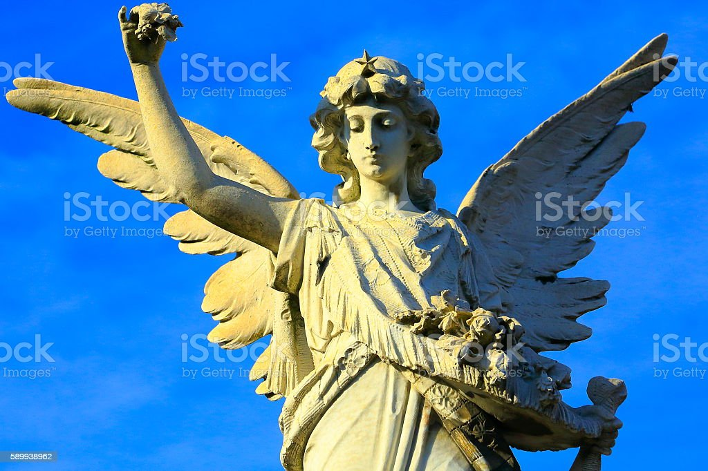 Lovely Justice Madonna Angel offering flower, blue Sky bright sunset stock photo