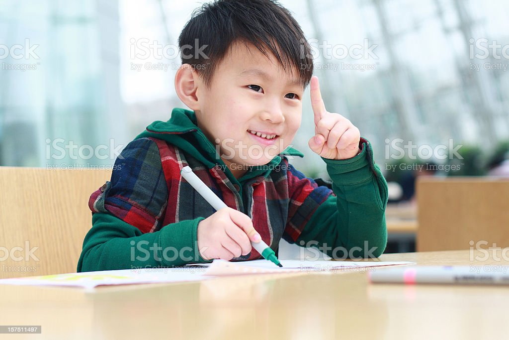 lovely kid in the library stock photo