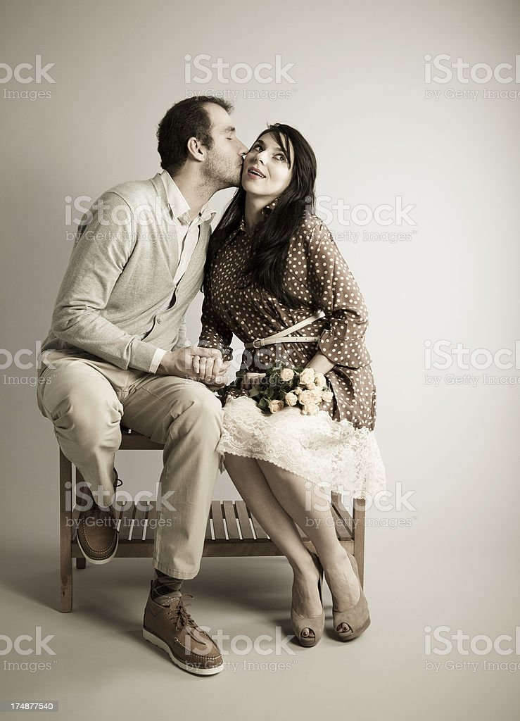 Lovely Kiss and Roses Bouquet. 8 March. Young Couple Date. royalty-free stock photo