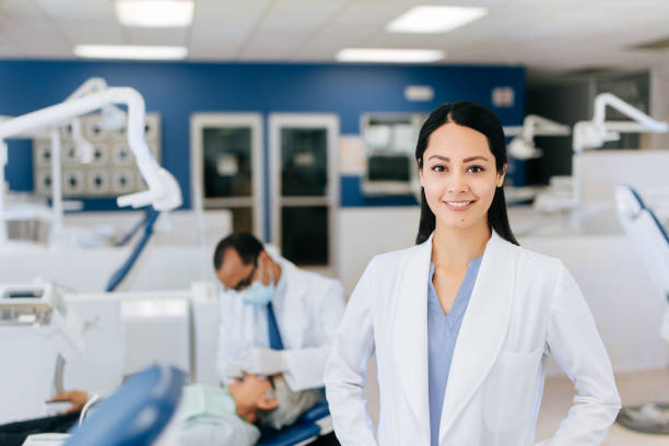 Lovely latin female dentist looking at the camera and smiling stock photo