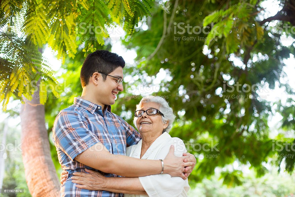 Lovely latin grandmother and grandson embracing – Foto