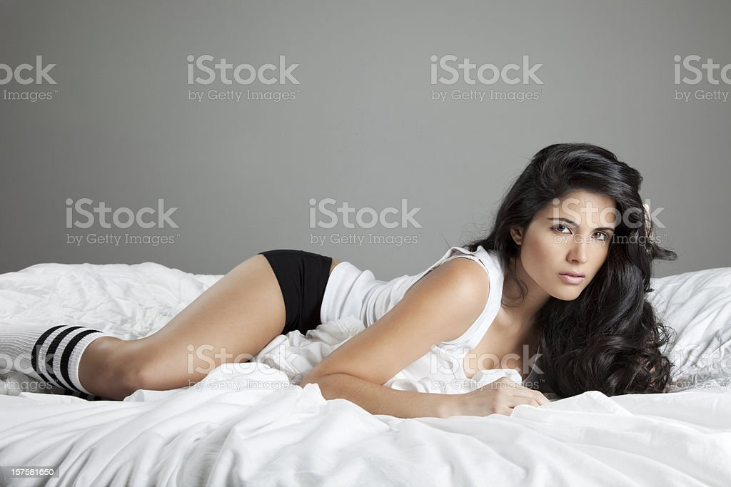 Lovely Latin Woman on Bed stock photo