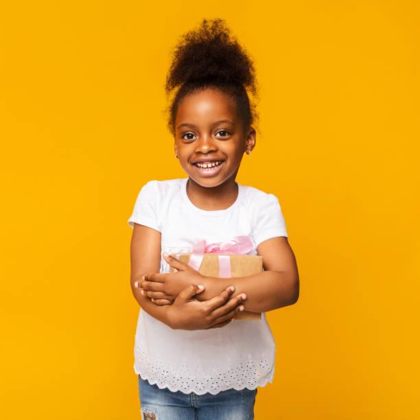 Lovely little african girl smiling with present box picture id1176739980?b=1&k=6&m=1176739980&s=612x612&w=0&h=9s f7 jznp5y2sl65rn gn3u fnwffjyslvvptbex5s=