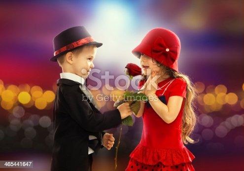 istock Lovely little boy giving  a rose to girl 465441647