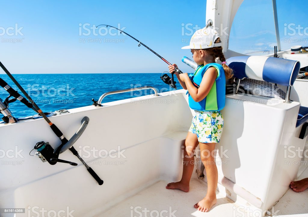 Lovely little girl fishing stock photo