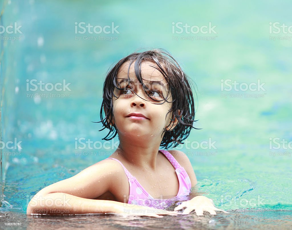 lovely little girl in the swmming pool royalty-free stock photo