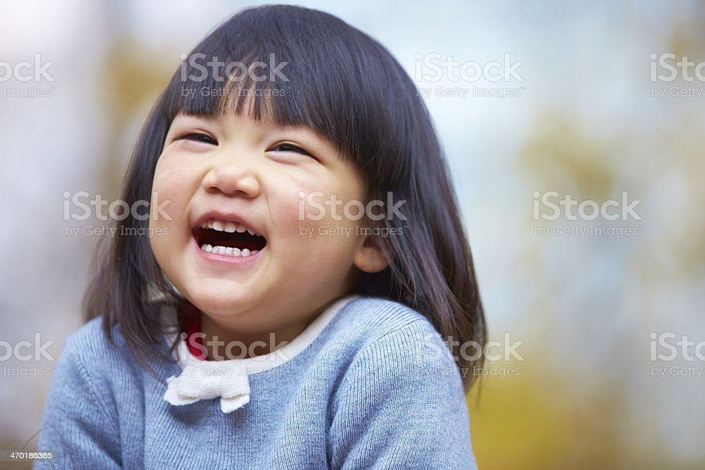 lovely little girl laughing stock photo