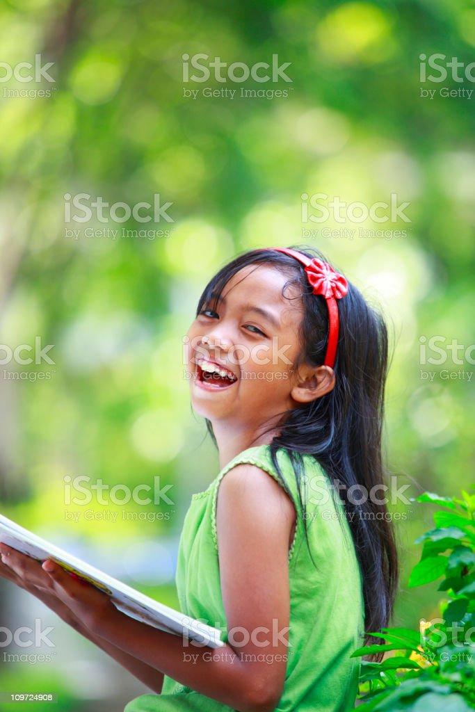 lovely little girl reading book stock photo