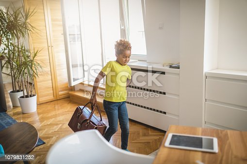 Cute and lovely child preparing for summer travels in a sunny apartment.