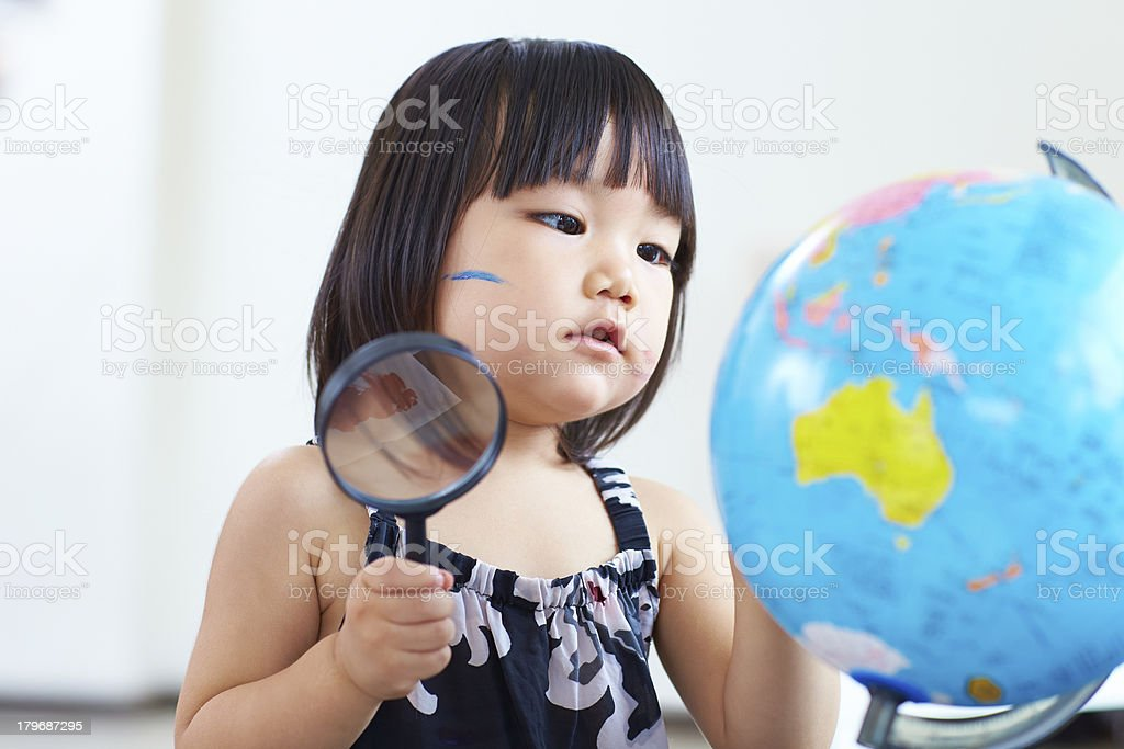 lovely little girl with globe royalty-free stock photo