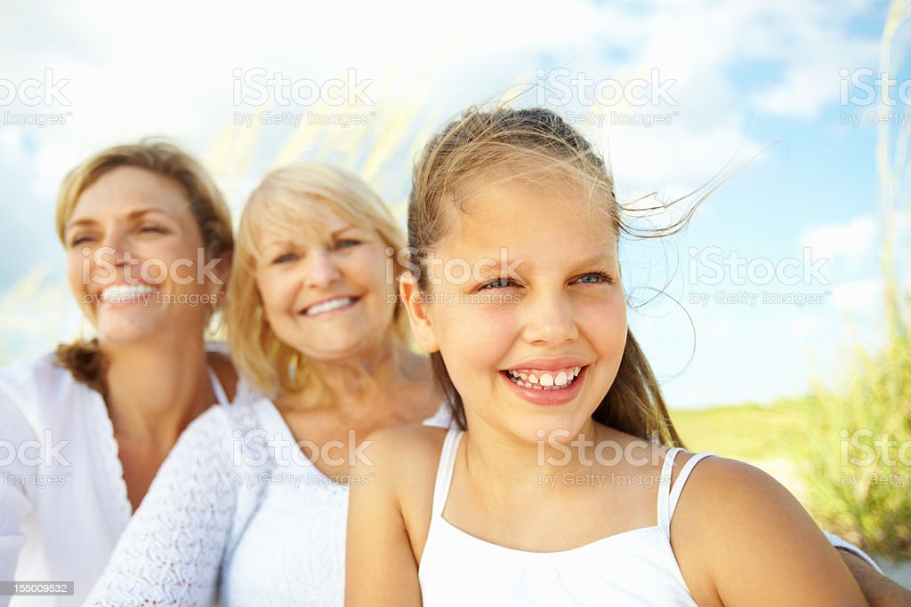 Lovely, little girl with grandmother and mother royalty-free stock photo
