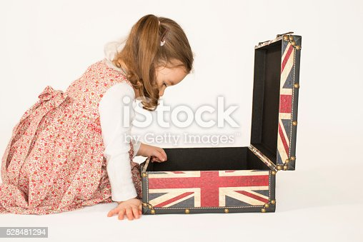 926982852 istock photo Lovely little girl with oldsuitcase 528481294