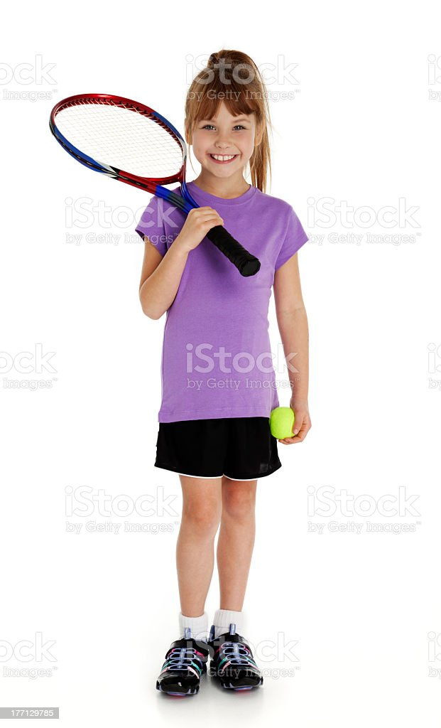 Lovely little happy girl ready for her tennis lessons stock photo