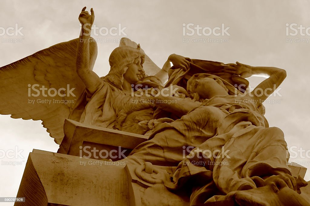 Lovely Madonna, beautiful Angel couple mausoleum, dramatic sky, Recoleta Cemetery stock photo