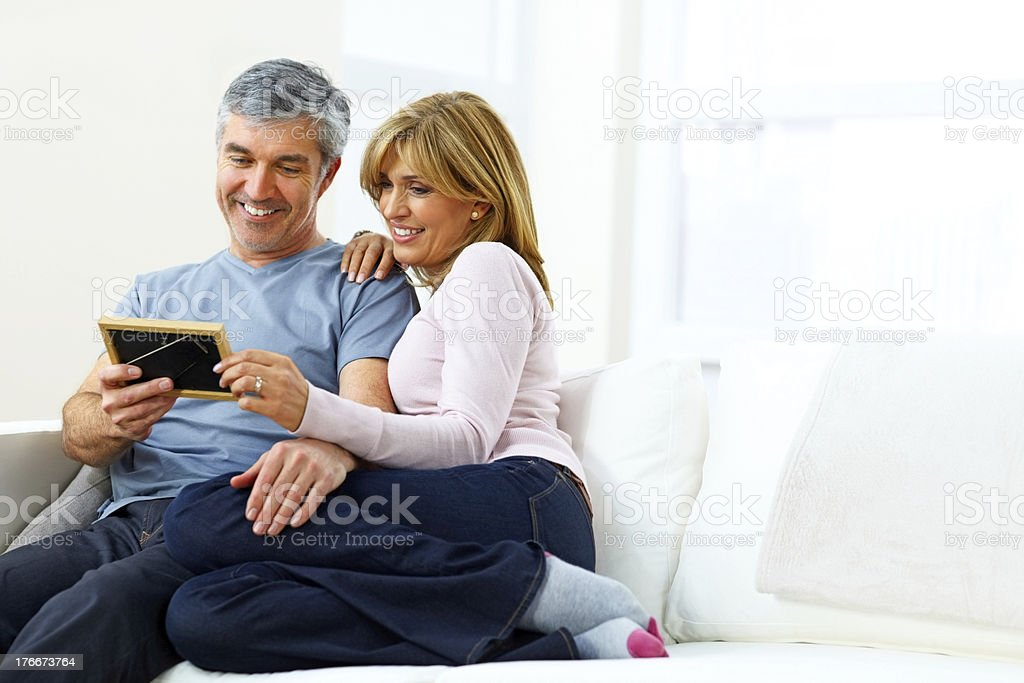 Lovely mature couple looking at photograph royalty-free stock photo