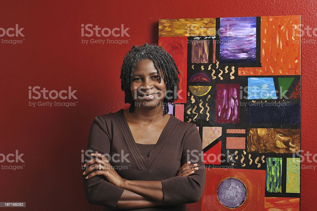 Lovely middle-aged black painter stock photo
