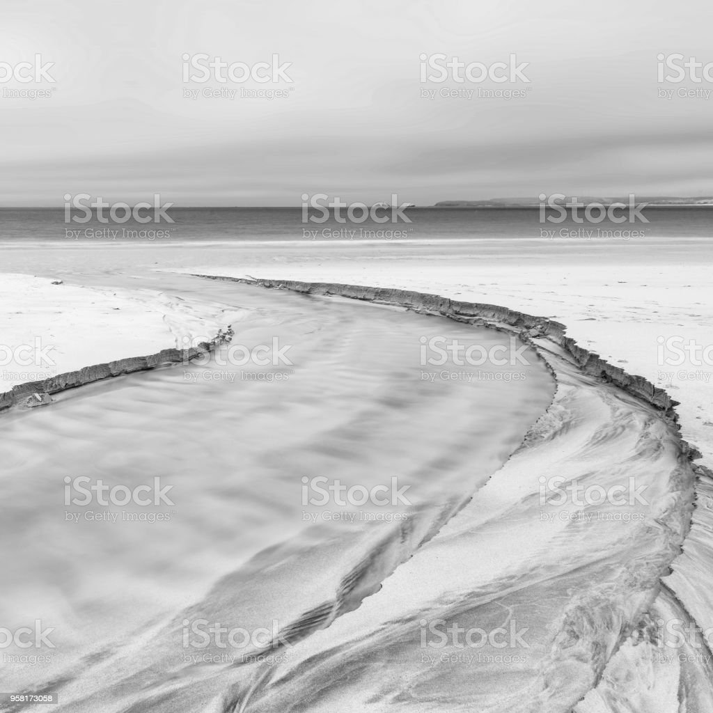 Lovely minimalist landscape black and white image of empty beach at...