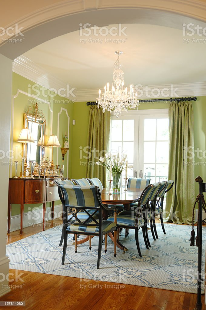 A lovely modern dining room with a chandelier royalty-free stock photo