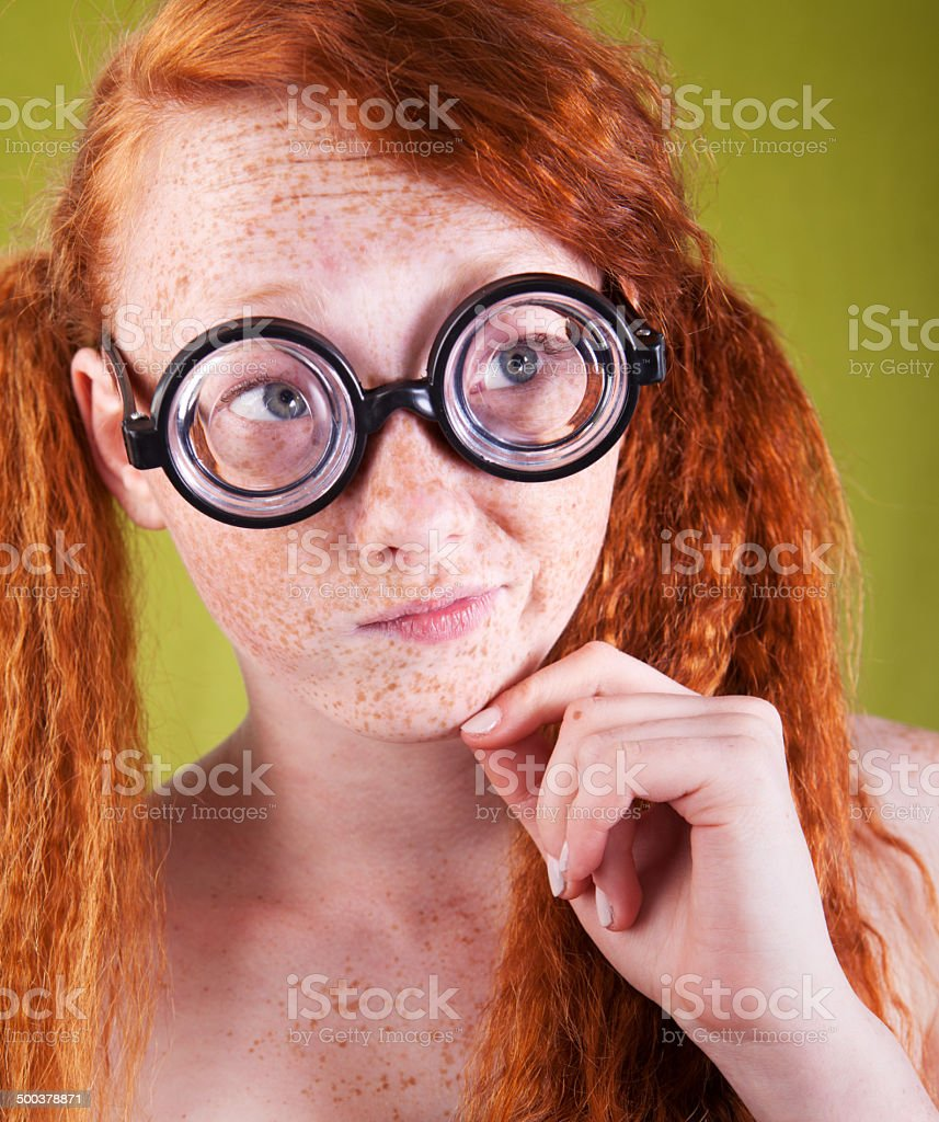Ginger nerdy girl in glasses and her friends having fun