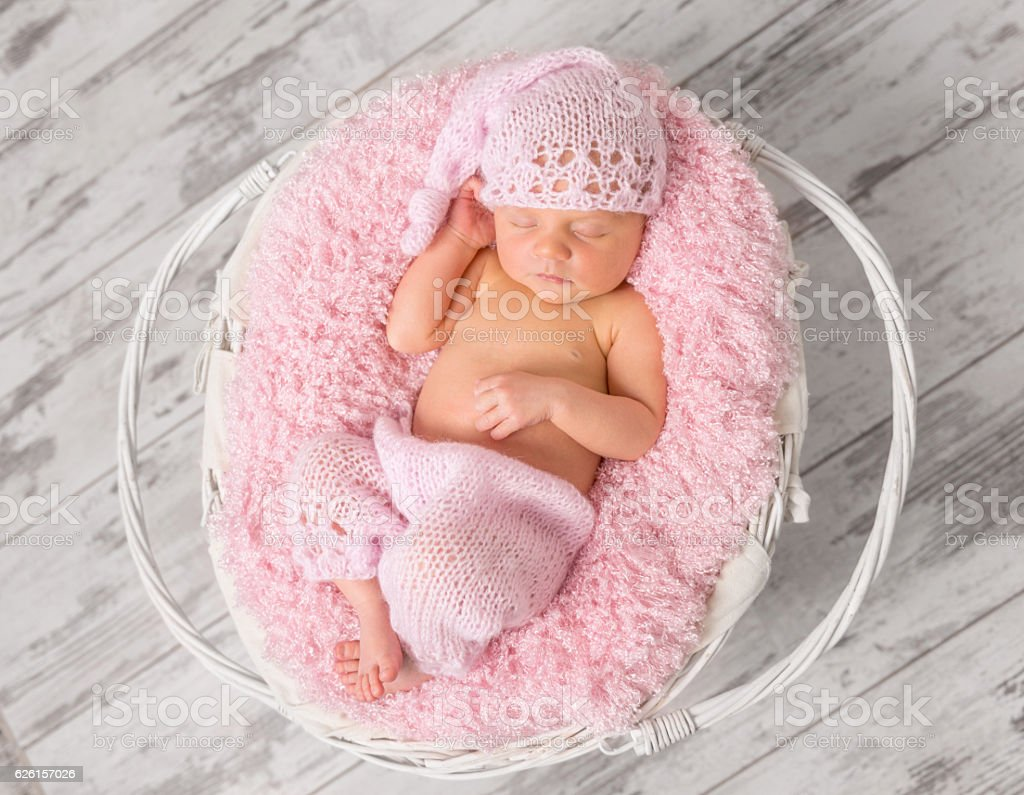 a05b2ecb2 Lovely Newborn Girl In Pink Panties And Hat In Basket Stock Photo ...