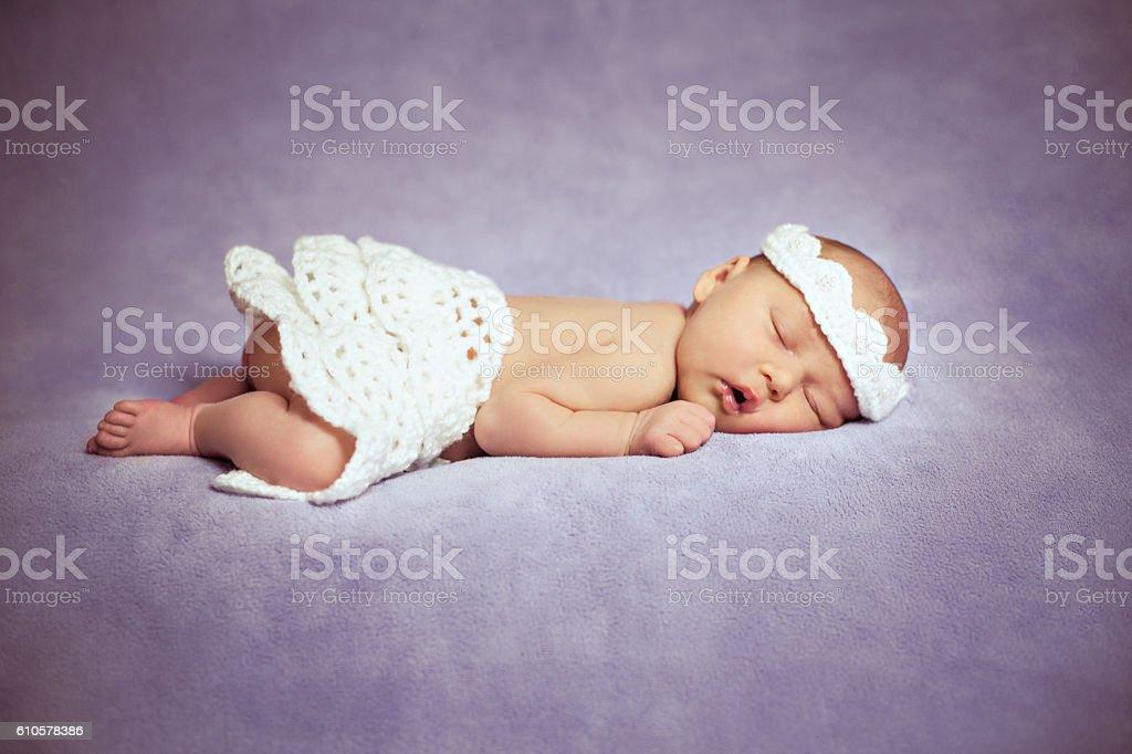 Lovely Newborn Girl Is Sleeping stock photo