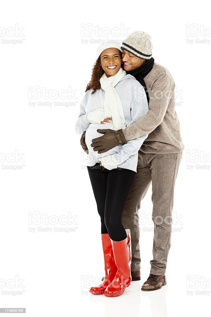 Lovely pregnant couple embracing on white royalty-free stock photo