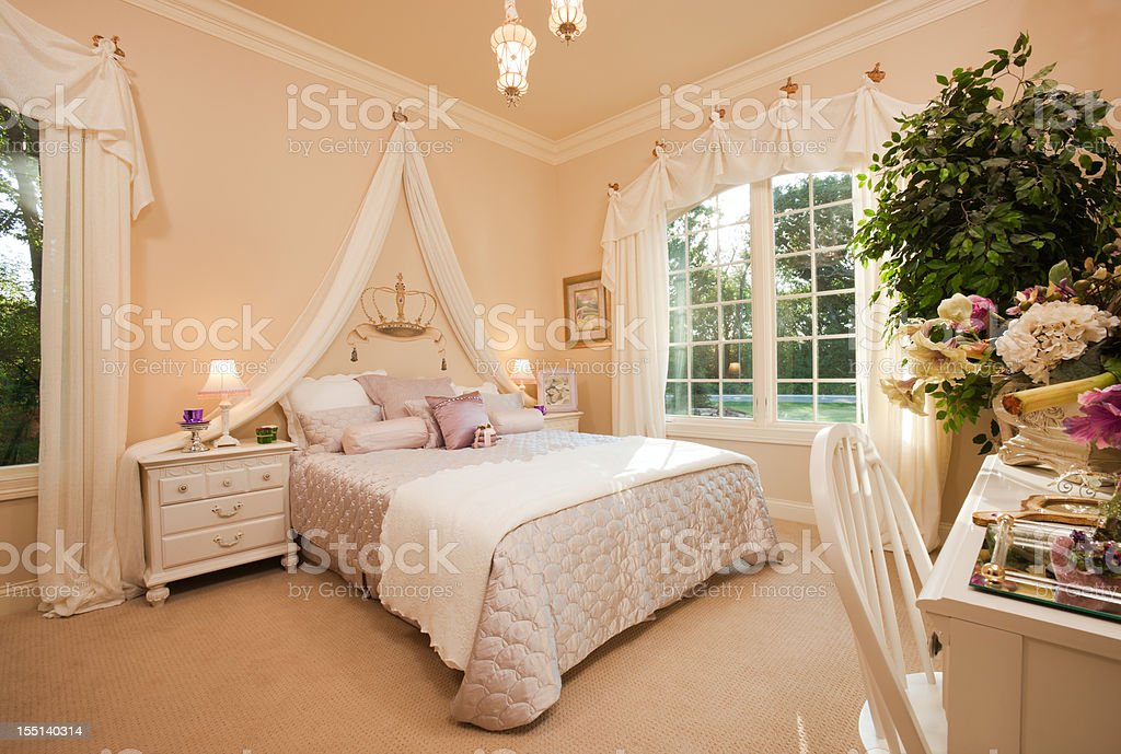 Lovely queen themed bedroom in residential home. stock photo