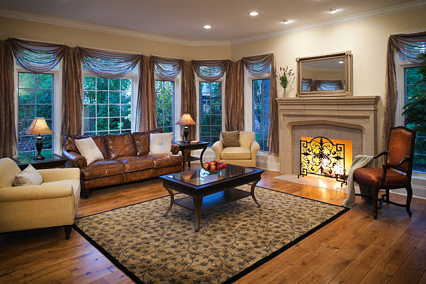 Lovely residential living room with burning fireplace. stock photo