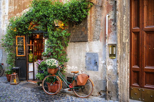 A lovely restaurant in the Trastevere district of Rome with an old fashioned bicycle