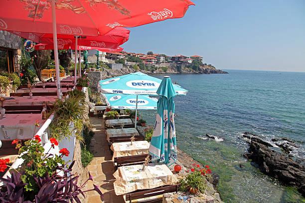 Lovely restaurant near rocky shores stock photo