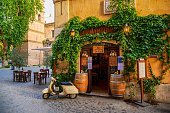 istock A lovely Roman restaurant in the ancient Trastevere district with a vintage Vespa 1226875281