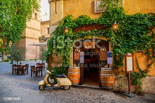 Rome, Italy, May 22 -- A typical roman restaurant with a scooter in the ancient Trastevere district, the most loved and visited district by the tourists of the ethereal city. Image in HD format.