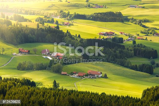 istock Lovely rural countryside in beautiful sunlight. Pasture landscape with barnyards. 912426620