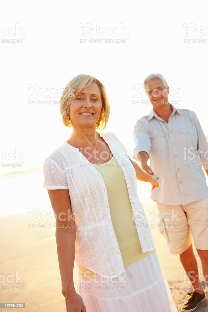 Lovely senior couple having fun on the beach royalty-free stock photo