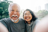 istock Lovely Senior Father and Daughter Taking Selfie Together 1198494596