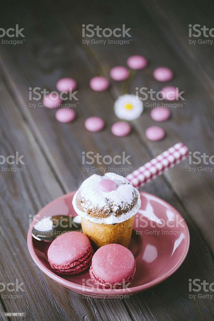 Lovely small cake and macaroons stock photo