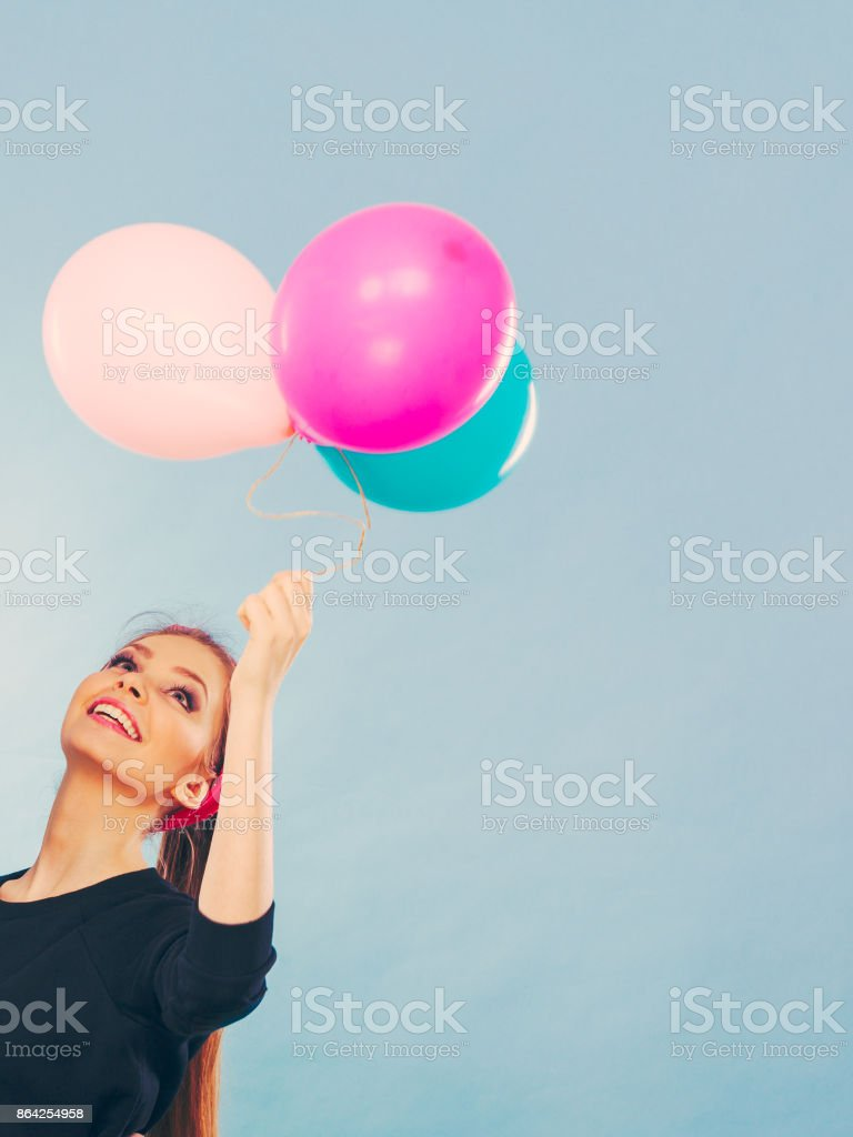 Lovely smiling girl holds colorful balloons. royalty-free stock photo