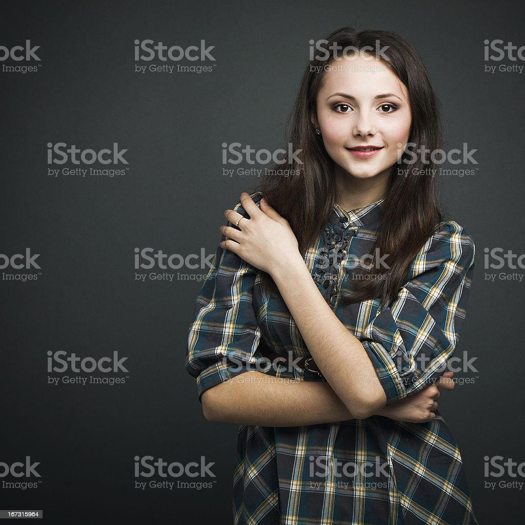Lovely smiling girl on dark background royalty-free stock photo