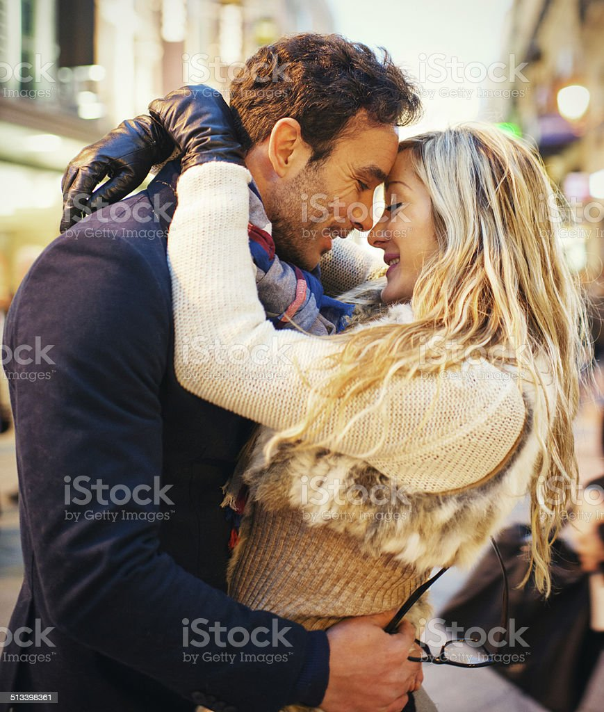 Lovely Spanish couple embracing on Madrid street stock photo