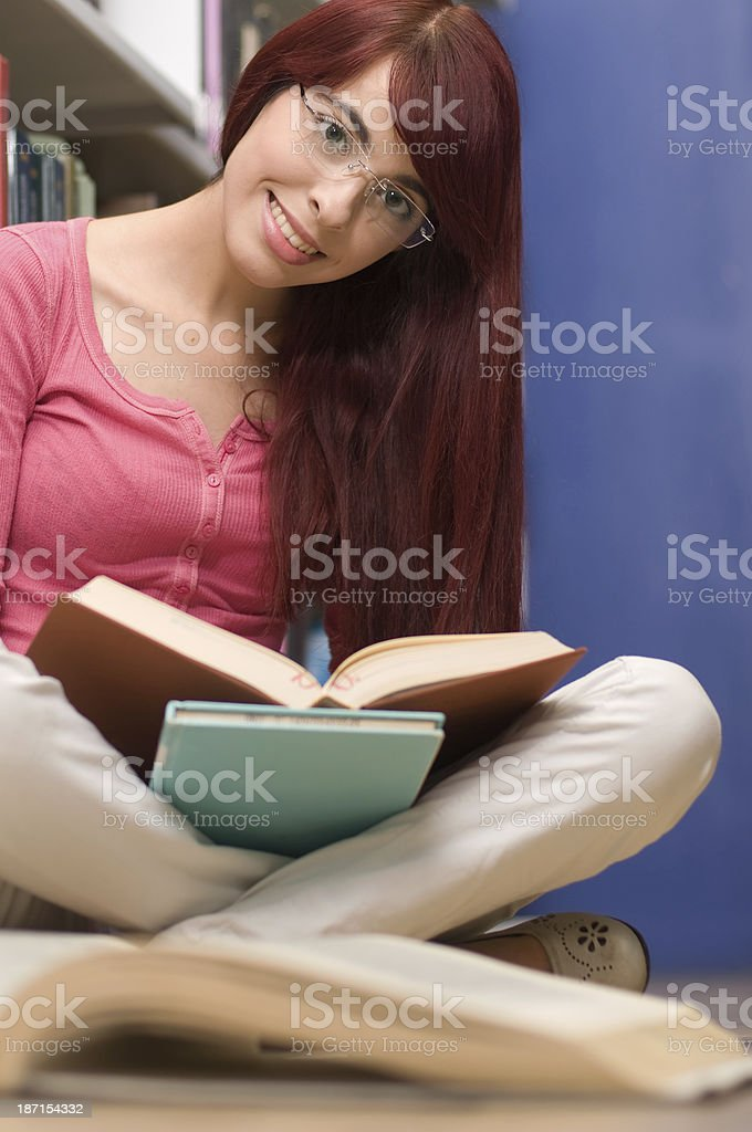 Lovely student in the library royalty-free stock photo