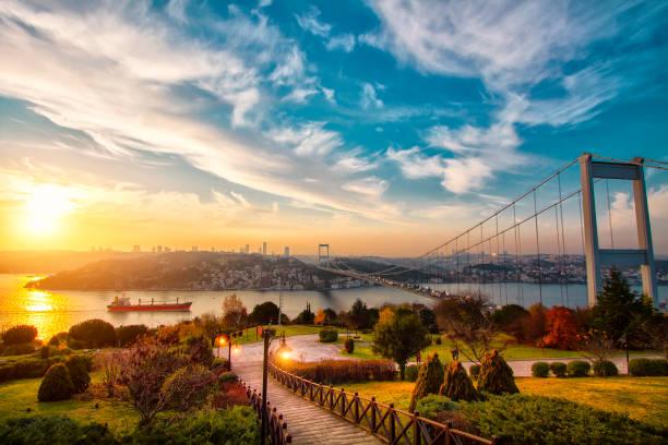 lovely sunset over bosphorus bridge istanbul turkey - стамбул стоковые фото и изображения