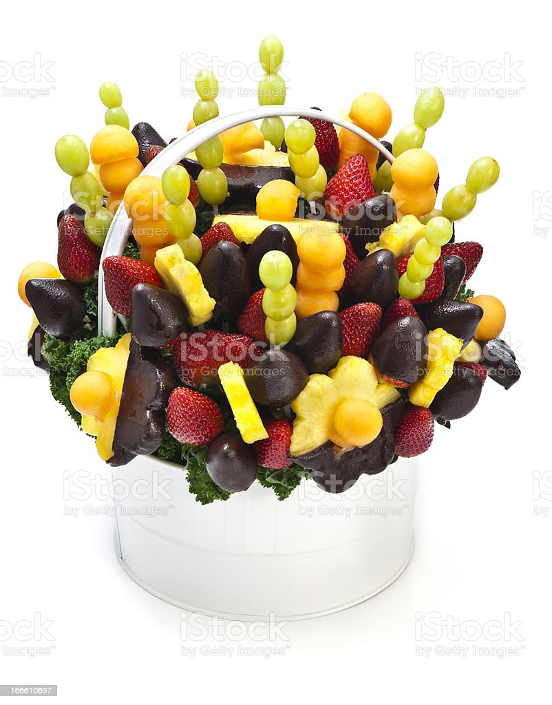 Lovely tropical fruit bouquet arrangement in a white basket royalty-free stock photo
