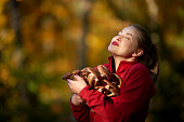 smiling young woman in the forest holding mushrooms and embracing it.relaxing time.