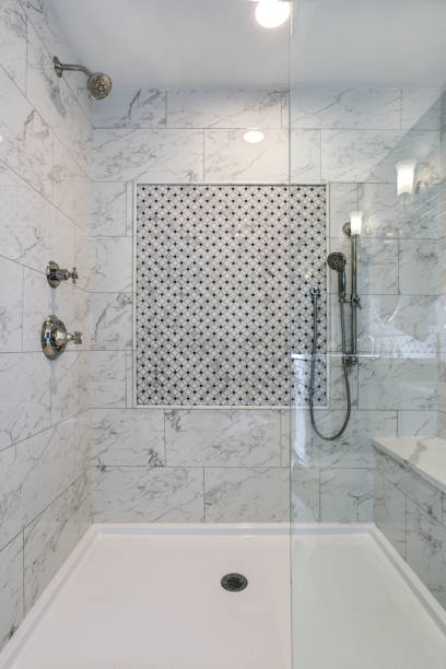 Lovely walk-in shower with carrera Marble Surround stock photo