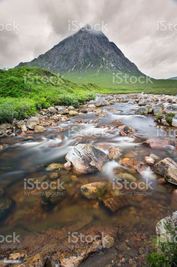 Lovely waterfall and mountain at Glen Etive near Glencoe stock photo