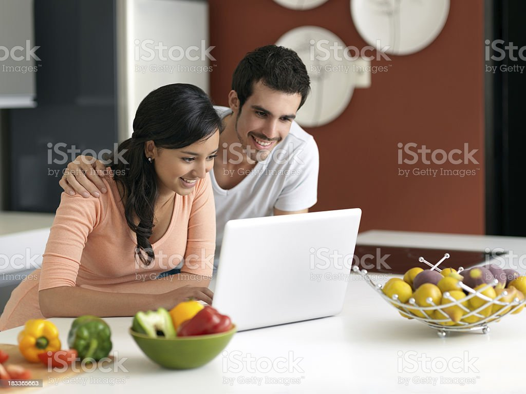 Lovely woman and man hanging out in the kitchen royalty-free stock photo
