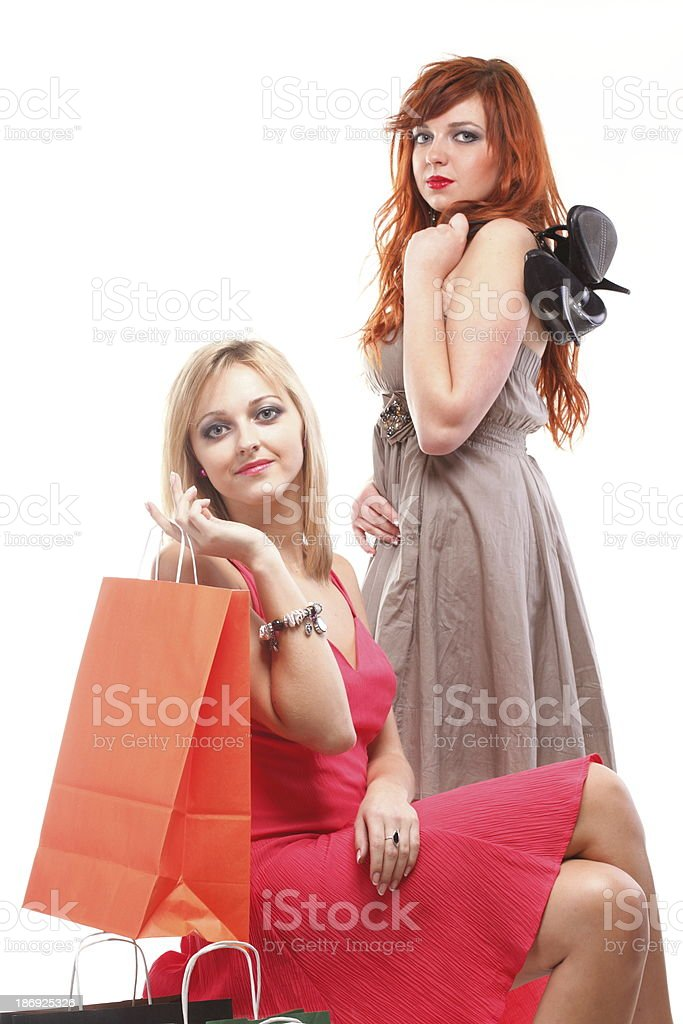 lovely woman ginger and blonde with shopping bags royalty-free stock photo