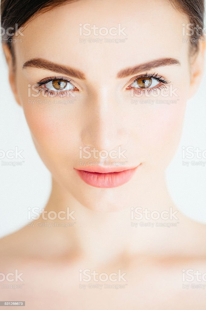 Lovely woman looking at the camera stock photo