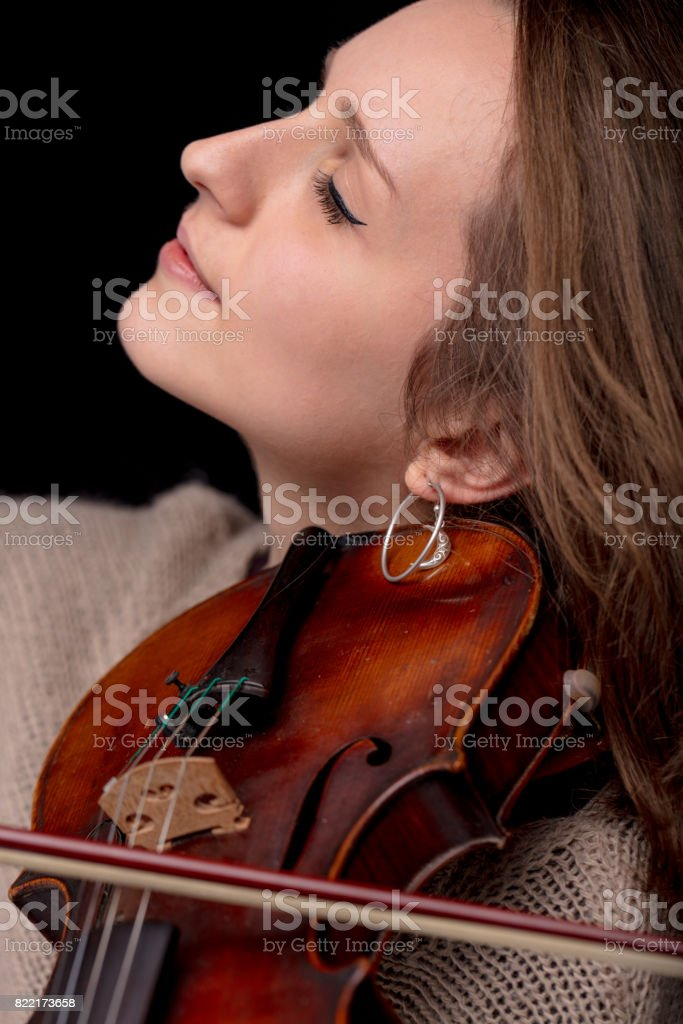 lovely woman side view with violin stock photo