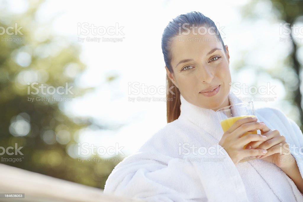 Lovely woman with a glass of juice royalty-free stock photo